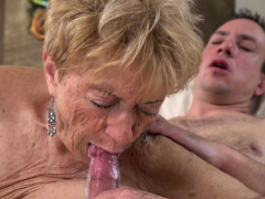 Busty grandma gives bj