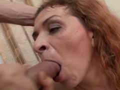 Redheaded mature gets penetrated and rewarded with a facial
