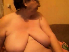 Mature  with huge boobs on webcam