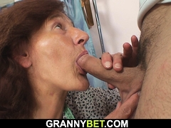 Young  pummels sewing 60 years old woman