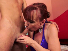 Redhead grandmother cockriding youthful guy