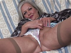 mature babe April upskirt and striptease show
