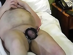 Granny strikes male slave cock with tennis ball cannon.