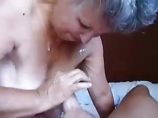 Granny jerking coupled with cum on tits