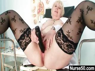 Big interior old lass in uniform fingers hairy pussy