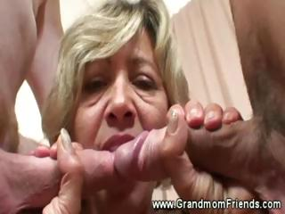 Titillating granny sucks coupled with tugs two cocks