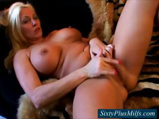GILF with broad in the beam hard breasts fingering