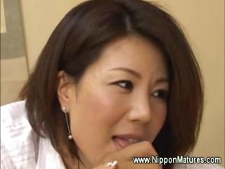 Asian licks fingers while arrhythmic a cock