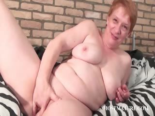 Busty mature fingering her pussy