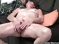 Sleazy grandma with saggy breasts finger fucks hairy cunt