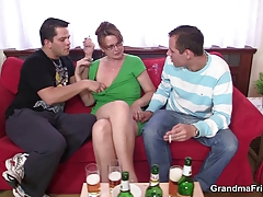 Mature lady is lured into threesome