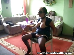 Mature MILF slave being tormented by masked man