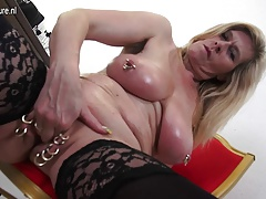 Massive titted heavily pierced German housewife stroking