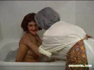Granny bathing younger lassie