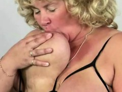 mature playing with her meaty boobs