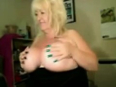 Busty blonde mature playing with tits