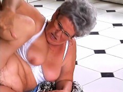 Mature dame with glasses has a hairy peach craving for some firm meat