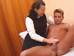 Unshaved granny in stockings fucked by boy