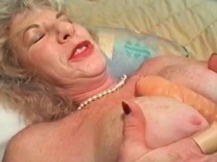 Messy mature likes using large sex toys