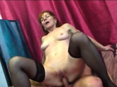 Big-chested brunette granny riding lengthy shaft on couch