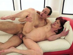 Ginger-haired granny spoon fucked by younger guy