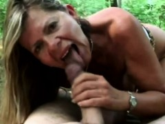 A lusty brunette mature woman sucks  man's dick