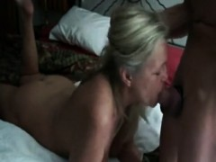 Milf deep throats cock of younger guy