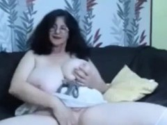 Hot busty granny showing her  tits in front of cam