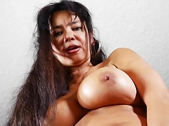 Mature American mommy with big globes and pussy