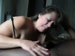 Grandma throating dark-hued penis